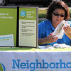 Aurora Lliadis, Senior Community Outreach Coordinator for Neighborhood Health Plan, was one of the many tables servicing families at the Family and Children's Service of Greater Lynn annual family fun day on Lynn Common today. Photo by Owen O'Rourke