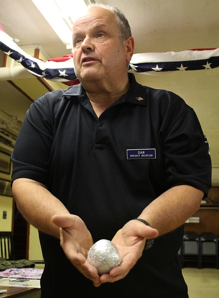 Dan Schroeder of the Wright World War ll Museum in N H showing and example of a tin foil ball that was saved by an American for the war effort during Worl War ll. The war ended before she could turn it in.  Photo by Owen O'Rourke