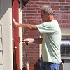 Mike Kwiatek closes and locks the door of the food pantry at St. Mary's for the last time at noon today. Photo by Owen O'Rourke