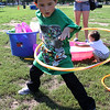 J J Laboy tries his hand at the hula hoop at the Family and Children's Service of Greater Lynn annual family fund day outing on Lynn Common today. Photo by Owen O'Rourke