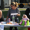 From left to right, Karina Chilel, Lorie Russel, Ingrid Aristy, work the EIPP Cerebral Palsy table at the Family and Children's Service of Greater Lynn annual outing on Lynn Common today. Photo by Owen O'Rourke