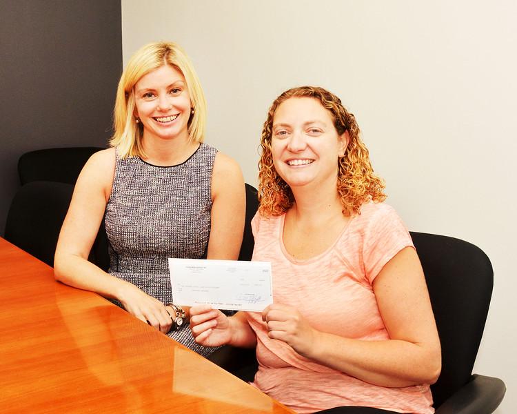 Lynn, Item offices.  Jen Barrows, Swampscott, is the winner of the Reader Survey.  Item CEO Beth Bresnahan on the left.