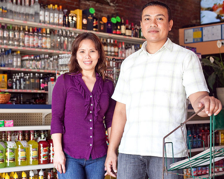 Navy Sar and Paul Pho pose for a photo at their new business, Lucky's Liquors, on Lewis Street on Friday, September 21. Item Photo / Angela Owens.