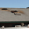 Holes cut in the roof of the Tides Restuarant in Nahant by fire fighters battling a fire there that started at 2:30 this morning. Photo by Owen O'Rourke
