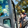 Marblehead, Touch-a-Truck event sponsored by the Marblehead Family Fund.  Nathaniel Bentley, aged 5 tries out the drivers seat of one of the trucks.  His father Andrew  Bentley watches with his younger son Lucas on his shoulders. All Marblehead.