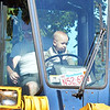 "Marblehead, Touch-a-Truck event sponsored by the Marblehead Family Fund.  Daniel Angelov, aged 16 months, experiences the drivers seat of a bull dozer.  Alexander Angelov is with him.  Both Marblehead.  ""The event is absolutely fabulous""  said Alexander."