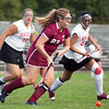 Gloucester's Chloe Flavin (23) takes the ball past Saugus High School's Shannon Gayron (19) and Sophia Cogliano (22) during their game at Stackpole Field on Monday, September 8. Item Photo / Angela Owens.