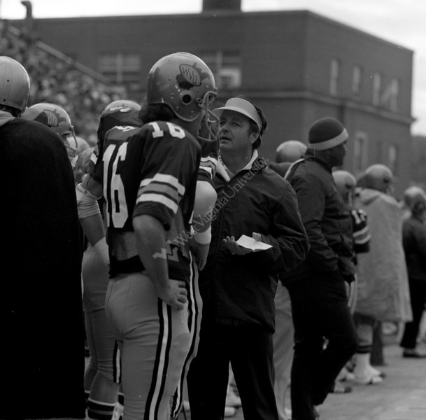 coach_and_players_on_sidelines_1