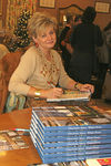 "<a href=""http://www.charlottemoss.com/live.php"">Charlotte Moss</a> signing a copy of her book <a href=""http://www.randomhouse.com/catalog/display.pperl?isbn=9781400054381"">""Winter House""</a>"