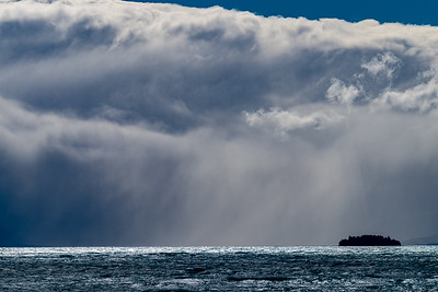 Storm clouds cover the entrance to the Tasman River accross Lake Pukaki. NZ