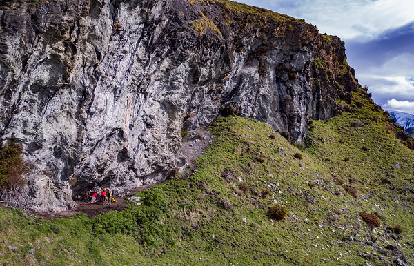 Manaaki Whenua Landcare Research scientists search for coprolites under overhangs on a schist cliff on Mt Nicholas Station near Lake Wakatipu.  Funded by the Marsden Fund