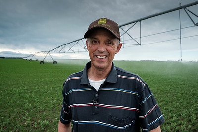 Steven Bierema in front of an irrigator which uses MVI.  Image by Brad White for Manaaki Whenua