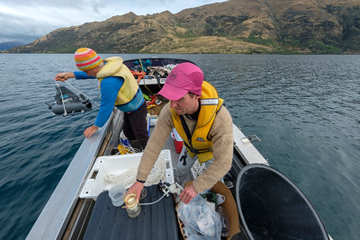 Manaaki Whenua researcher, phycologist Phi Novis PhD (light brown jersey) with University of Otago's Dr Marc Schallenberg collecting samples of Lake Snow from Lake Wanaka in the South Island of New Zealand.  Image for Manaaki Whenua by Bradley White