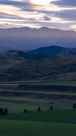 Early morning over farmland between Castle Hill Peak to the right Cave Stream to the extreme left near SH73.