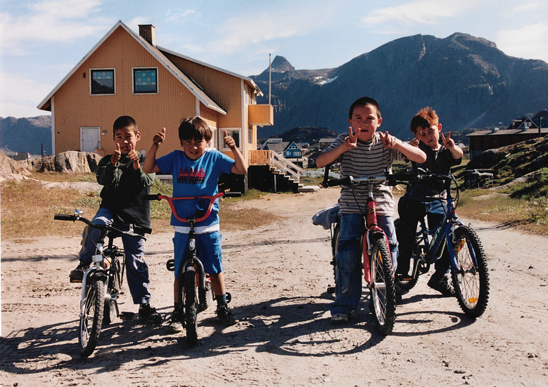 Innuit children playing on Bikes at Sisimiut, Greenland