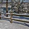 wood fence under snow