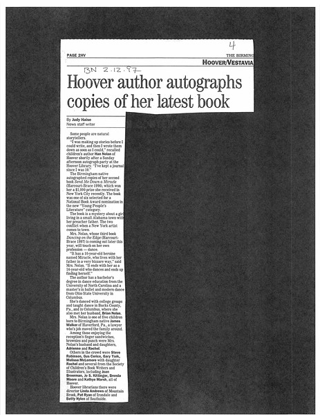 Hoover author autographs copies of her latest book
