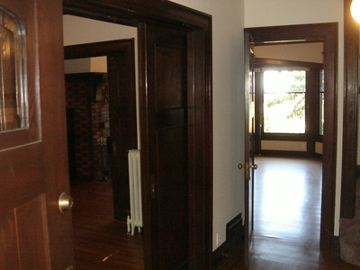 Entry, parlor on left, living room straight