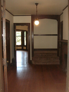 Entry, Parlor on left, Living room straight, Kitchen on right