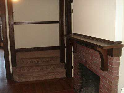 Entry, fireplace, stairs up