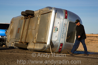 An overturned RV trailer fouls holiday traffic in rural Arizona
