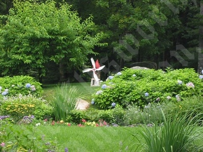 Safe 'N Sound - This is just one of the charming features you will see in this organically maintained garden.
