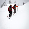 Skiers heading out on to the Arm