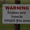 Warning sign - This field has insects and snakes lurking in the grass.