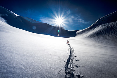 Backcountry skiing in the Pacific Northwest. Here a skier sets a track toward the next objective.