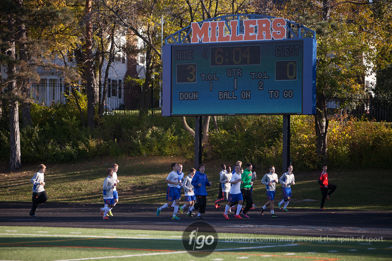 Boys warmed up under the scoreboard that read the Washburn girls score en route to their 4-0 win Saturday.