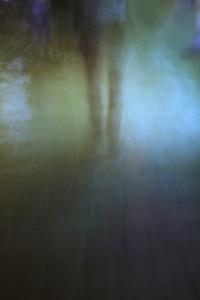 Person walking in the dark