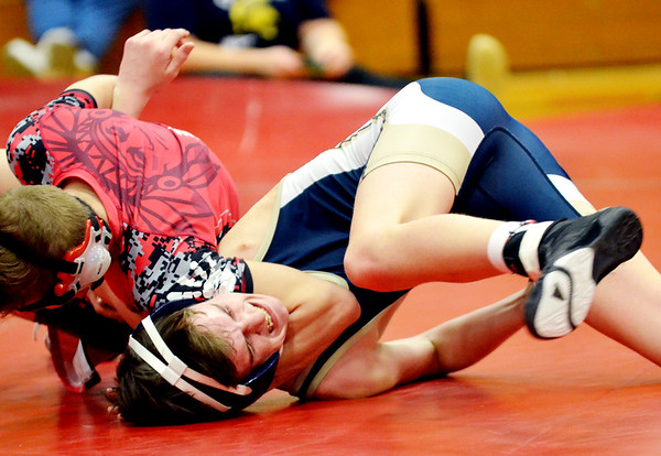 WARREN  DILLAWAY | Star Beacon<br /> Edgewood's Josh Phares (far left) tries to pin Conneaut's Riley Williams during a 113 pound bout on Thursday night at Edgewood.
