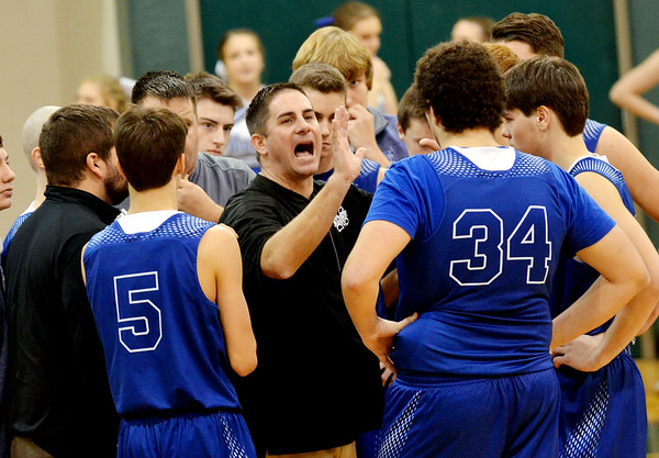 WARREN  DILLAWAY | Star Beacon<br /> Madison boys basketball coach Nick Gustin instructs his team during a timeout on Saturday at Lakeside.