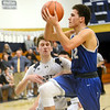 WARREN  DILLAWAY | Star Beacon <br /> Conneaut's Blaine McGlaughlin (10) defends Grand Valley's Malik Mitchell (12) defends on afternoon Saturday at Garcia Gymnasium in Conneaut.