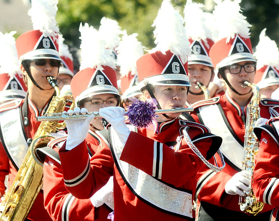 WARREN  DILLAWAY | Star Beacon<br /> Members of the Geneva High School band decorate their instruments in purple during the Grape Jamboree parade on Saturday in Geneva.