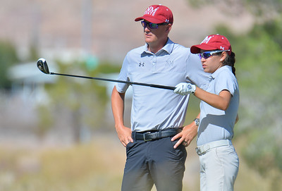 LAS VEGAS, NV - OCTOBER 22:  Maria Prado of the New Mexico State Aggies talks to head coach Danny Bowen on the eight hole during the 2017 Las Vegas Collegiate Showdown at the Boulder Creek Golf Course in Boulder City, Nevada.  (Photo by Sam Wasson)