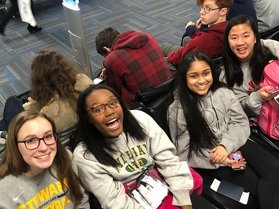 Hannah, Kennedy, Anya, and Lizzie are excited at Dulles airport ready to board the flight to Beiijing.