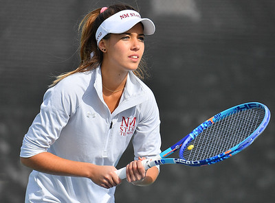 LAS VEGAS, NV - JANUARY 20:  Eli Arnaudova of the New Mexico State Aggies prepares to receive serve during her team's match against McKenna Lloyd of the Weber State Wildcats at the Frank and Vicki Fertitta Tennis Complex in Las Vegas, Nevada. Amaudova won the match 7-5, 6-2.