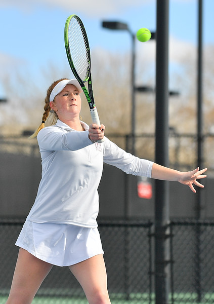 LAS VEGAS, NV - JANUARY 20:  Rebecca Keijzerwaard of the New Mexico State Aggies plays a forehand during her team's doubles match against McKenna Lloyd and Sara Parker of the Weber State Wildcats at the Frank and Vicki Fertitta Tennis Complex in Las Vegas, Nevada. New Mexico State won the doubles match 6-3.