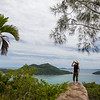 A female tourist overlooking Baie St Anna on Praslin island in the Seychelles.