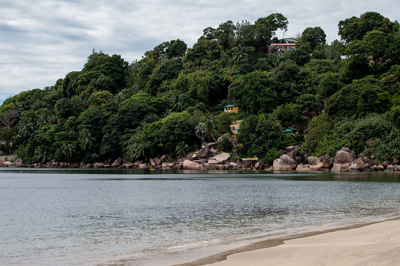 View of houses overlooking Anse Marie-Louise on Praslin island in the Seychelles.