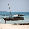 A boat anchored off Nakupenda Sandbar near Stone Town, Zanzibar.