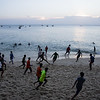 Locals gather for an informal footie match on the beach in Stone Town, Zanzibar in Tanzania.