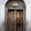 An elaborate mosque door in the backstreets of Stone Town in Zanzibar, Tanzania.