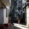 A female tourist wanders the alleys of Stone Town, Zanzibar in Tanzania.