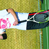 WARREN DILLAWAY / Star Beacon<br /> KEVIN MAURER, a third singles tennis player for Edgewood, gets a drink between games Monday afternoon during a home match with  Struthers.