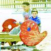 WARREN DILLAWAY / Star Beacon<br /> TEAMU QUIGLEY, 18, and Isaac Lopez, 4, of Ashtabula, enjoy an afternoon of fun at Lake Shore Park in Ashtabula Township on Monday.