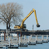 WARREN DILLAWAY / Star Beacon<br /> HEAVY EQUIPMENT dredges Conneaut Harbor on Tuesday afteroon from Broad Street Extension.