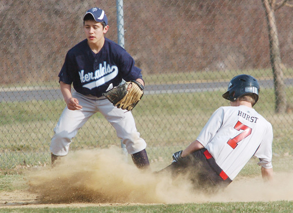 WARREN DILLAWAY / Star Beacon<br /> JAMES WOOD (4) of St. John waits for the ball as Nathan Hurst of Hearts for Jesus Christ slides safely into third base on Tuesday at Smith Field in Ashtabula.