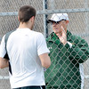 WARREN DILLAWAY / Star Beacon<br /> BOB WALTERS, Lakeside boys tennis coach, talks with first singles player Kyle Downs on Thursday during a home match with Geneva.